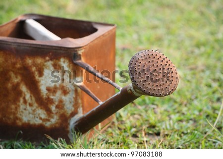 grunge watering can - stock photo