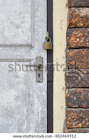 Grunge white door and old brick wall background