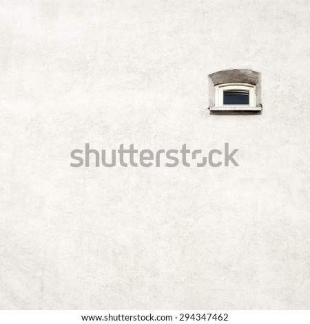 Grunge white old cracked wall with a small window background - stock photo