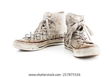 Grunge white sneakers on white background. - stock photo