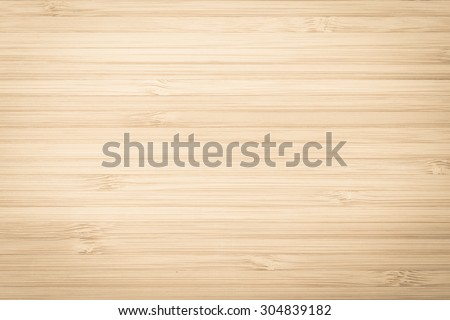 Grunge wooden textured grainy detail backdrop in natural light yellow cream brown color tone: Bamboo wood laminated board detailed texture pattern background in creme beige toned colour           - stock photo