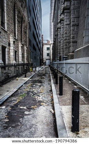 Grungy alley in Philadelphia, Pennsylvania. - stock photo