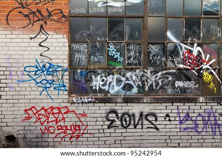 Grungy alleyway in Denver Colorado with graffiti. - stock photo