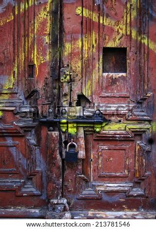Grungy ancient Door with Padlocks - stock photo