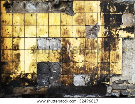 Grungy background: dirty, destroyed tiled wall, with holes and dirt