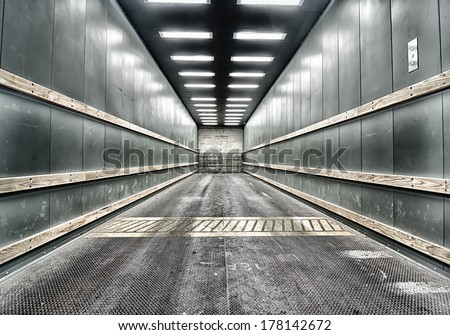 Grungy background shot of green car elevator - stock photo