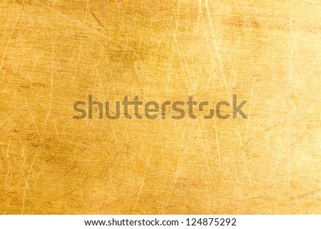 Grungy brushed yellow metal plate - stock photo