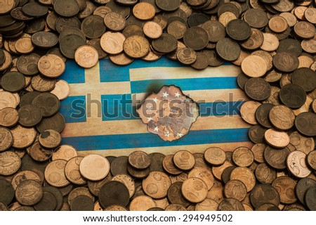 grungy burnt Flag of Greece on euro coins background - stock photo