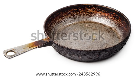 Grungy cast iron skillet isolated on white background