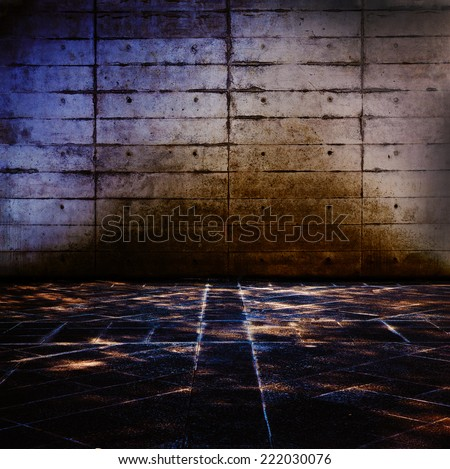 Grungy concrete and stone room with mysteriously illuminated stone floor. - stock photo