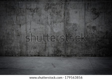 Grungy concrete wall and stone floor room as background - stock photo