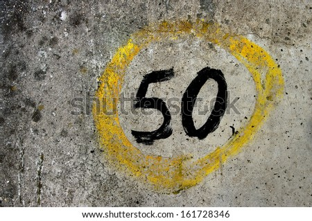 Grungy hand painted number 50. - stock photo