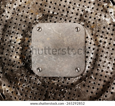 Grungy metal background. Frame with bolted to a perforated metal panel