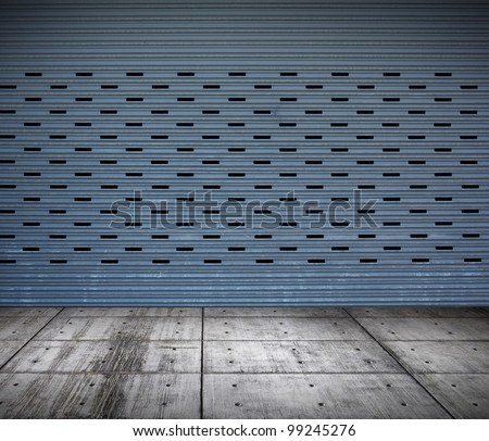 grungy metal industrial plates room with rolled up door - stock photo