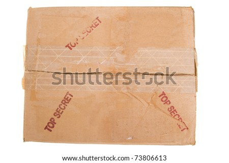 Grungy Old Cardboard Box TOP SECRET Peeling Tape - stock photo