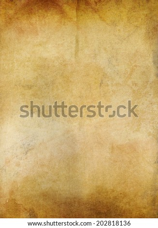 grungy old ocher paper background - stock photo
