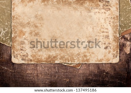 Grungy old paper on wood