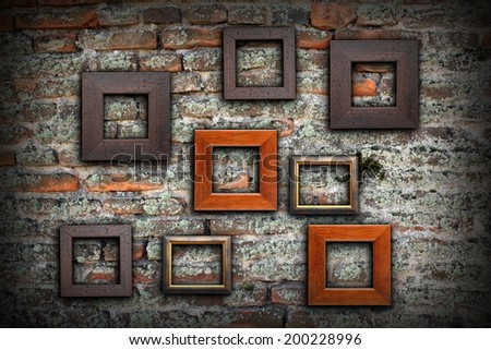 grungy old wall full of wooden frames for your message or design, artistic backdrop - stock photo