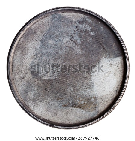 Grungy round metal plate isolated on white - stock photo