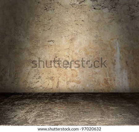 Grungy stained concrete room with bare walls - stock photo
