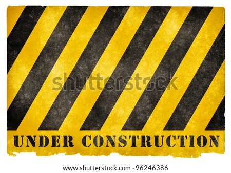 Grungy Under Construction Sign on Vintage Paper - stock photo