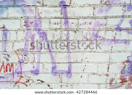Grungy urban background of a brick wall with an old out of service payphone on it / Brick wall background, texture for graffiti / Graffiti brick wall, colorful background - stock photo