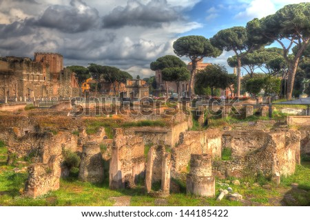 Grungy vintage picture of archaeological site near via dei Fori Imperiali in Rome styled as Renaissance Tuscan landscape. - stock photo