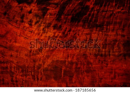 Grungy wood surface, Stained or varnished heavily used  antique wood surface. Wood has burls and curly stripe grain.  - stock photo