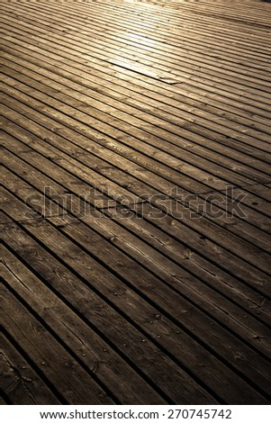 Grungy wooden planks floor in early morning light.  - stock photo