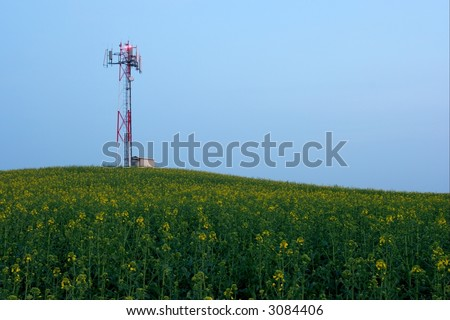 Gsm transmitter station on an agricultural field - stock photo