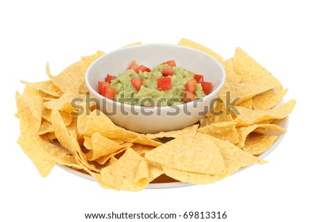 Guacamole and chips isolated over white background - stock photo