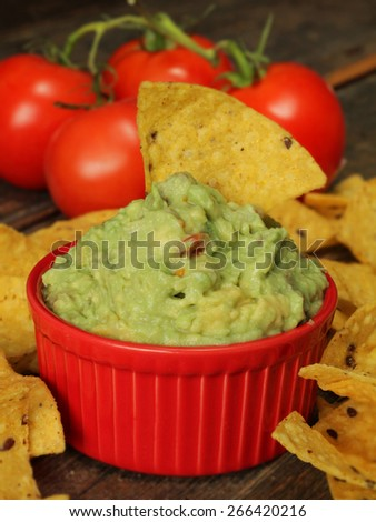 Guacamole dip with corn chips - stock photo