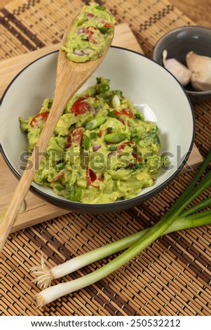 Guacamole with green onions. Selective focus. - stock photo