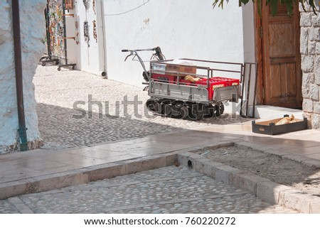 Guadalest, Spain, August 09, 2014: Mini Crawler Trolley with box of beer or water or limonade, transportation