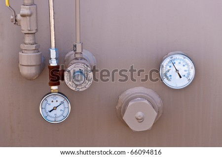 Guages On An Oil Pup - stock photo