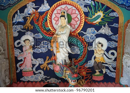 Guan-yin riding the green dragon and the followers