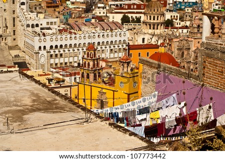 GUANAJUATO, GUANAJUATO/MEXICO - FEBRUARY 19: Guanajuato World Heritage Site and historic city, locals traditionally hang washing on colorful rooftops shown on February 19, 2010 in Guanajuato, Mexico. - stock photo