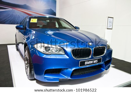 GUANGZHOU, CHINA - APR 28: BMW M5 blue sport car on display at the 2012 Guangzhou daily BaiYun INT'L Auto-expo,on April 28, 2012 in Guangzhou China,This is a large international car exhibition - stock photo