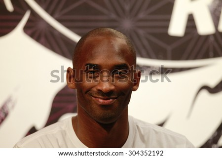 GUANGZHOU, CHINA - AUG 2. 2015:NBA basketball player Bryant Kobe of Los Angeles Lakers smiles during a promotional event at a store in Guangzhou. - stock photo