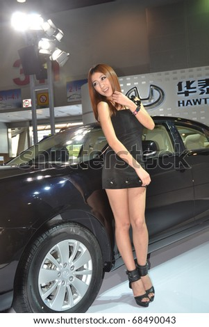 GUANGZHOU, CHINA - DEC 27: Fashion Model on car at the 8th China international automobile exhibition on December 27, 2010 in Guangzhou China. - stock photo