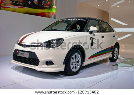 GUANGZHOU, CHINA - DEC 1:MG 3 white car on display at the 10th China(Guangzhou) International Automobile Exhibition. on Dec 1, 2012 in Guangzhou China. - stock photo