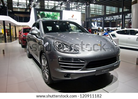 GUANGZHOU, CHINA - DEC 1:PORSCHE cayenne car on display at the 10th China(Guangzhou) International Automobile Exhibition. on Dec 1, 2012 in Guangzhou China. - stock photo