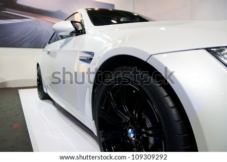 GUANGZHOU, CHINA - JUL 29: BMW M3 car on 2012 Guangzhou Imported Luxury Automobile Exhibition,on July 29, 2012 in Guangzhou China,This is a large international car exhibition - stock photo