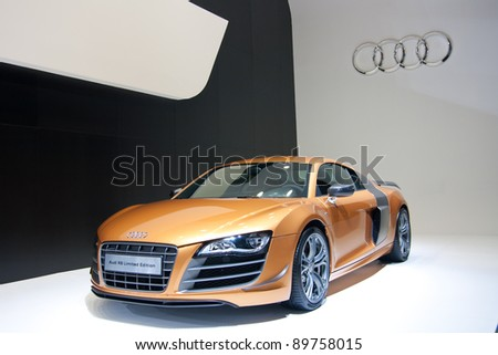 GUANGZHOU, CHINA - NOV 25:AUDI R8 orange sport car on display at the 9th China(Guangzhou) International Automobile Exhibition. on November 25, 2011 in Guangzhou China. - stock photo