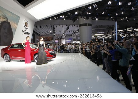 GUANGZHOU, CHINA - NOV. 22. 2014: Cadillac stand during the 12th China International Automobile Exhibition in Guangzhou, Guangdong province. - stock photo