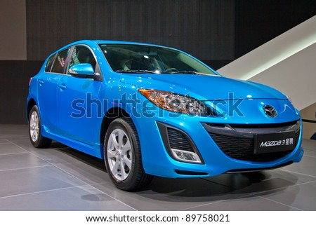 GUANGZHOU, CHINA - NOV 25:MAZDA M3 blue car on display at the 9th China(Guangzhou) International Automobile Exhibition. on November 25, 2011 in Guangzhou China. - stock photo