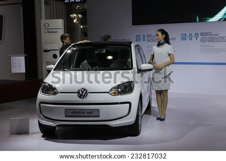 """GUANGZHOU, CHINA - NOV. 22. 2014: Volkswagen """"Electric Up"""" vehicle on the 12th China International Automobile Exhibition in Guangzhou, Guangdong province. - stock photo"""