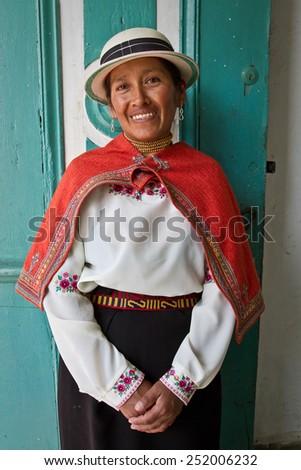 GUARANDA, BOLIVAR, ECUADOR - APRIL 27, 2012 : Portrait of indigenous woman from Guaranda Ecuador wearing traditional clothing - stock photo
