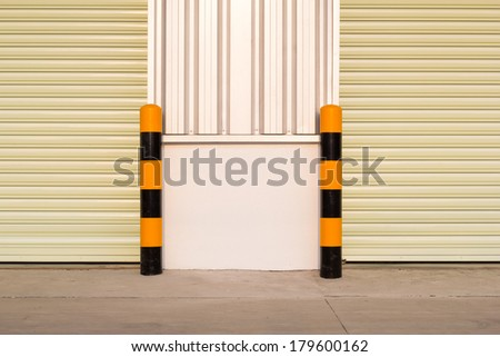 Guard post column for prevent car or truck hit edge of door. - stock photo