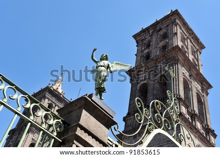 Guardian angel above Mexican Catholic Church in Puebla city Mexico. - stock photo